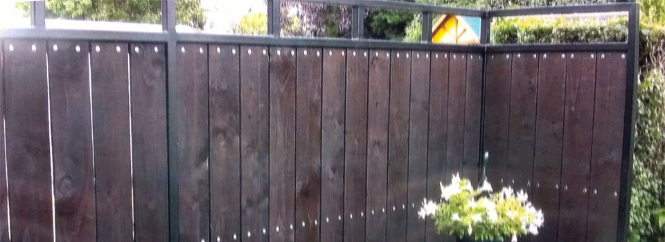 wrought-iron-with-wood-fencing-slide1